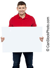 Casual guy presenting ad board. Advertise your business here
