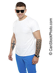 Handsome guy wearing shades and posing over white background