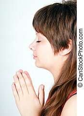 ger girl folded her hands in prayer Profile view