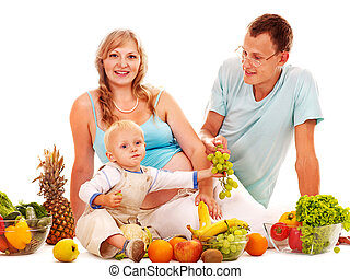 Family pregnant woman preparing food - Family with pregnant...