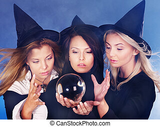 Young woman with crystal ball Fortune Telling - Group young...