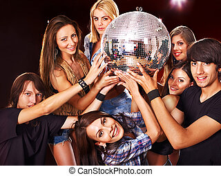 Woman on disco in night club. Disco ball.