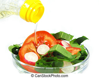 Olive oil and salad from vegetables