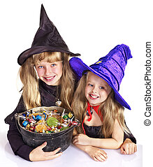 Witch with trick or treat. - Witch children with trick or...
