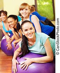 Women in aerobics class. - Women group in aerobics class.