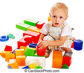 Children play building blocks - Happy children playing...