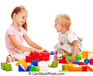 Children play building blocks. - Happy children playing...