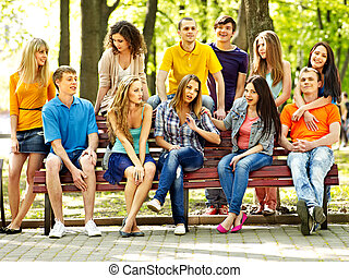 Group people outdoor. - Group people on bench outdoor.