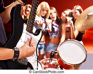 Band playing musical instrument - Musical group playing in...