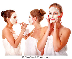 Group women with facial mask. - Young woman getting facial...