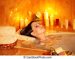 Woman take bubble bath - Young woman take bubble bath with...