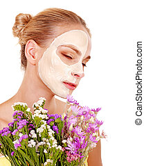 Woman with facial mask. - Woman with facial mask holding...