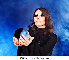 Young woman with crystal ball - Woman holding crystal ball...