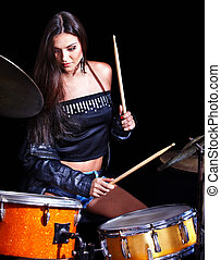 Woman playing drum and cymbals. - Young woman playing drum...