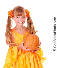 Girl in orange long dress with pumpkin at...