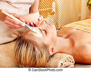 Woman getting facial massage . - White woman getting facial...