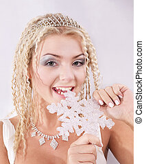 Young woman holding snowflake.