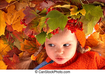 Girl child in autumn orange leaves Outdoor