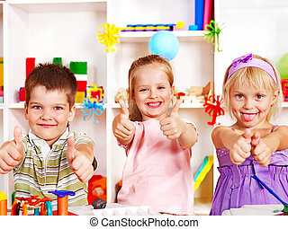 Child cutting out scissors paper. - Group of children in...