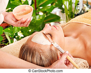 Woman getting facial massage . - Woman getting facial mask...