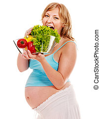 Pregnant woman eating vegetable. Isolated.