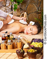 Woman getting thai herbal compress massage . - Woman getting...