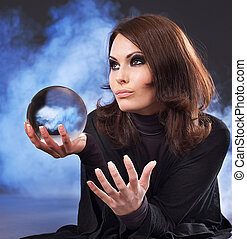 Young woman with crystal ball - Young beautiful woman with...