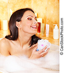 Woman take bubble bath - Young woman take bubble bath