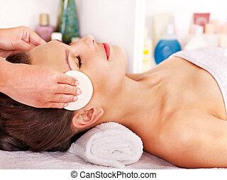 Woman getting facial massage . - Young woman getting facial...