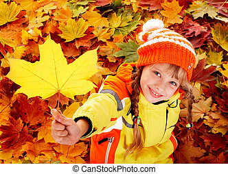 Child in autumn orange leaves. - Little girl in autumn...