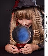 Girl holding crystal ball. - Little girl witch holding...