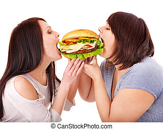 Women eating hamburger Isolated
