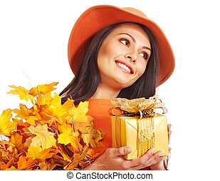 Woman holding autumn gift box .