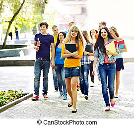 Group student outdoor. - Group student with notebook on...