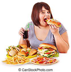 Woman eating fast food - Overweight woman eating fast food