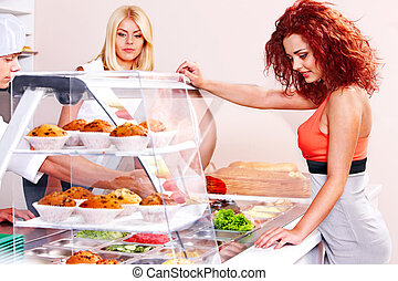 Group people at cafeteria - Women at cafeteria buying food