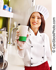 Female chef uniform. - Female chef uniform at cafeteria. The...