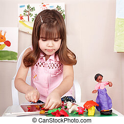 Child playing with plasticine in school. - Little girl...
