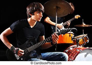 Men playing  guitar. - Men playing  guitar in night club.