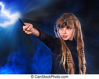 Girl in witch's hat with magic wand. - Girl in witch's hat...
