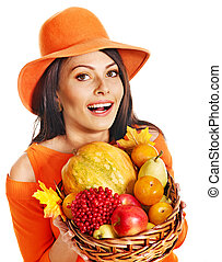 Woman holding autumn basket - Woman holding autumn basket...