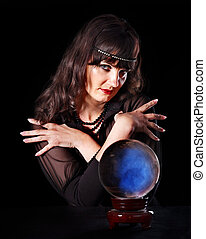 Young woman with crystal ball Beauty and fashion