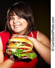 Woman holding big hamburger - Overweight woman holding big...