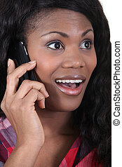 Woman expressive on phone