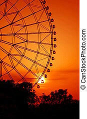Romantic Wheel Red - evening shot of a sightseeing weel in...