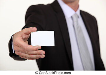 Cropped executive with a blank businesscard