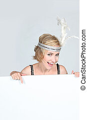 Woman in a flappers outfit with a board left blank for your...