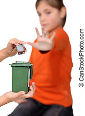 Kids illustrating improper disposal of batteries