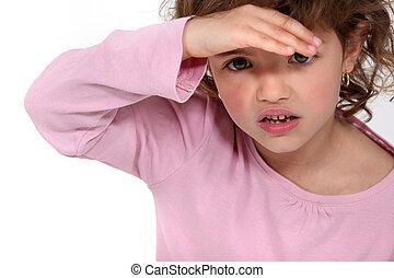 Little girl shielding her eyes
