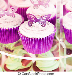 Cup cakes - Selection of fresh iced cup cakes on a stand at...